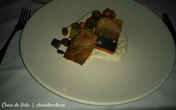 Artic char with roasted carrots, sultanas, sunflower seeds, and raita